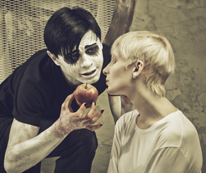 Mime teasing a woman with an apple